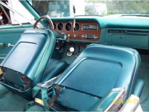 pontiac gto  restored cameo ivory  color turquoise interior