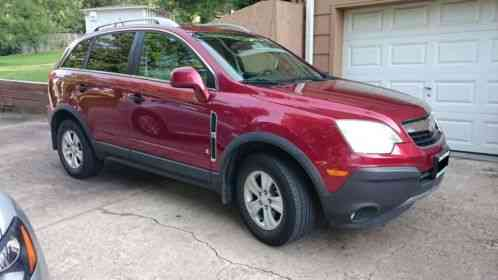 saturn vue 2009 for sale is a red xe awd v6 with only 53 xxx miles. Black Bedroom Furniture Sets. Home Design Ideas