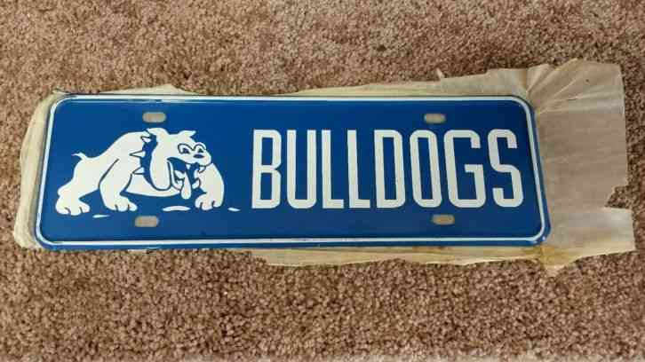 Vintage nos montana bulldogs license plate topper for Pa fishing license prices