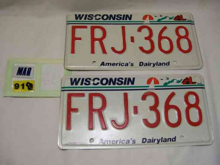 Pair of Unused Wisconsin License Plates & 1991 Stickers