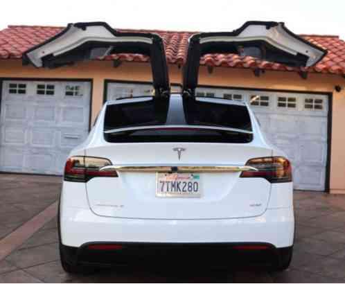 tesla model y black exterior white interior